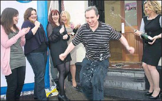 Jerry Kennelly CEO, tweak.com, celebrates with staff members, Heather Costelloe, Niamh Hennessy, Catriona Sayers, Ell Moran, at the launch of his company 'tweak.com' which went live across the globe at his Killorglin Offices on Sunday. Credit: Photo by Valerie O'Sullivan