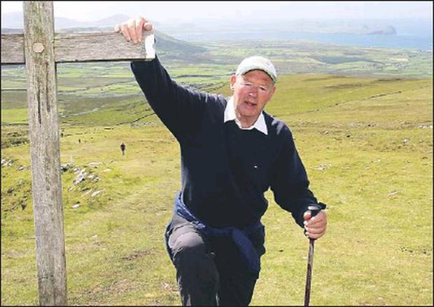 Micheál Ó Muircheartaigh celebrating his 80th birthday by climbing Mount Brandon last year. Credit: Photo by Ted Creedon