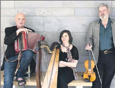 Breanndán Ó Beaghlaoich (left) with Laoise Kelly and Tommy Peoples will play at Ionad Culturtha on Friday, February 3 at 8-30pm. Credit: www. paulmccarthyphotography. com Photograph courtesy of