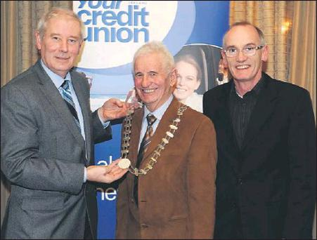 Christy Killeen, Chairman Chaper 23 Credit Union (left) handing over the Chain of Office to Incoming Chapter President Tom Lawlor with (right) Declan Malone Editor The Kerryman who launched the Chapter 23 AGM Report at the Chapter 23 launch of the... Credit: Photo by Michelle Cooper Galvin.