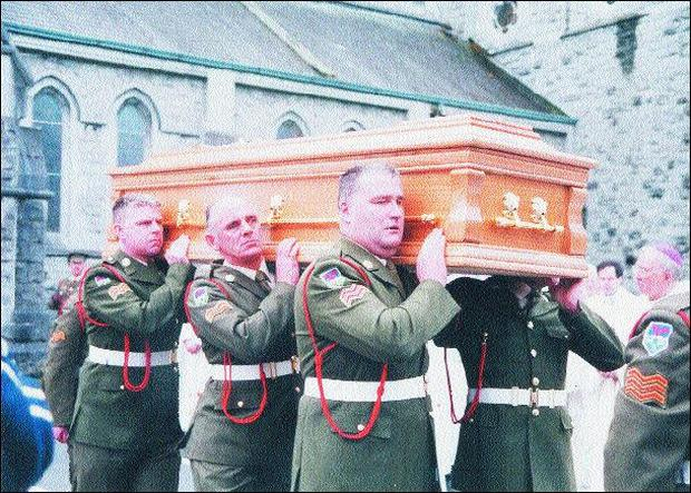 Army personnel carry Archbishop Courtney's remains from the church to the hearse. Pic. John Long.By Gerry Slevin
