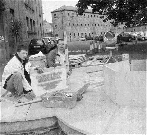 Ray Cregg, Cregg Brothers Stonework and Darragh Trapp working on the podium for the bronze statues of the three Olympic champions with Nenagh roots. Pic: John Long.Nenagh prepares to honour its Olympic champions