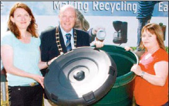 Cliona Connolly, enviromental education officer, Wexford County Council; Cllr Peter Byrne, chairman, Wexford County Council; and Siobhan Kehoe of water services, with one of the new rainwater saver butts.