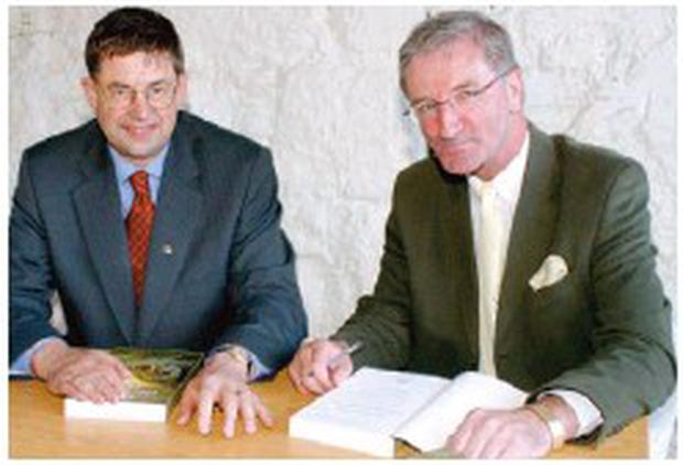 Local solicitor Simon Kennedy with Minister Eamonn O Cuiv as he launched 'The Year The Whales Came In' back in 2004.