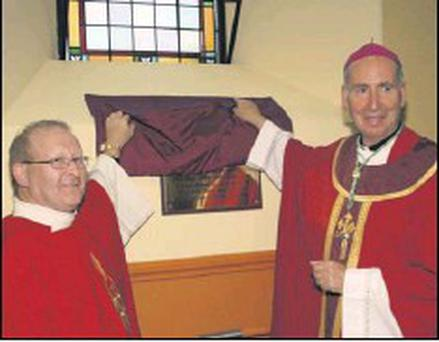 ■ Fr Bernard Cushen (PP Ramsgrange) and Bishop Denis Brennan unveiling the plaque in Ramsgrange Parish Church.