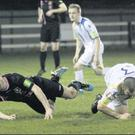 Shane Nolan of Wexford Youths is taken down by Waterford United's captain, John Frost, in their league clash at Ferrycarrig Park. Frost received a red card for the tackle.