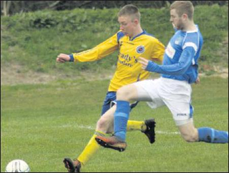 Luke Gorley of Roslare Strand and Trevor Breen from Enniscorthy United compete for possession in their Division 2 clash on Sunday last.