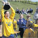 New Ross captain Jennifer White lifts the cup.