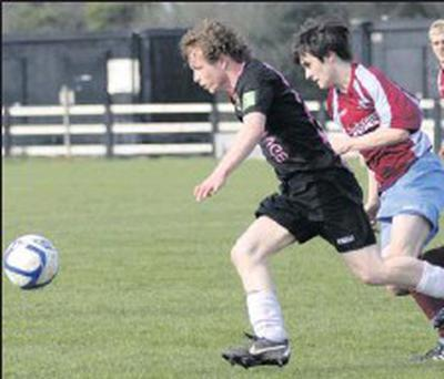 Conor Mccarney of Wexford Youths flies past Eric Neary of Mervue United in their game at Ferrycarrig.