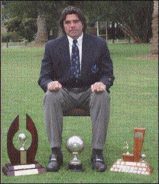Kevin Fallon pictured with some of the trophies won by the Mount Albert Grammar School Soccer Academy