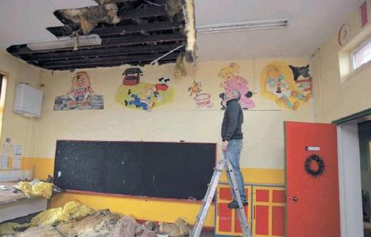 Caretaker Francis McGowan, inspecting the damage done by burst pipes in one of three class rooms at the Mercy Primary School, Pearse Road, Sligo.