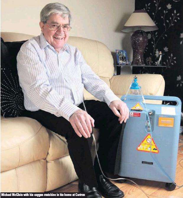 Michael McGloin with his oxygen matchine in his home at Cartron