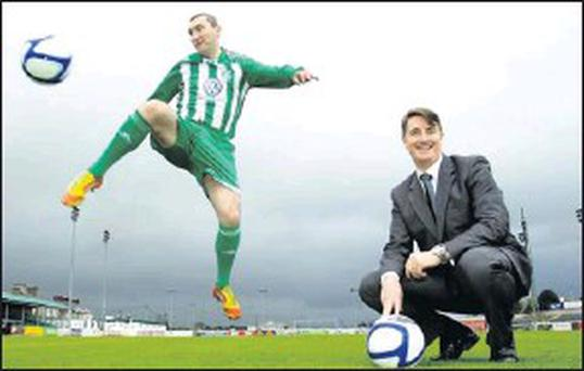 Pictured at Volkswagens title sponsorship announcement of Bray Wanderers F.C. are player Jason Byrne with Simon Elliott, Managing Director of Volkswagen Group Ireland.
