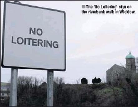 The 'No Loitering' sign on the riverbank walk in Wicklow.