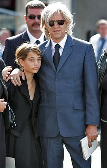 Bob Geldof with daughter Tiger Lily at his father's funeral at St Joseph's Church in Glasthule, Co Dublin yesterday. Photo: Frank McGrath