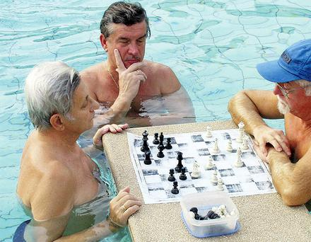 Local men concentrate on a game of chess at the Szechenyi Baths