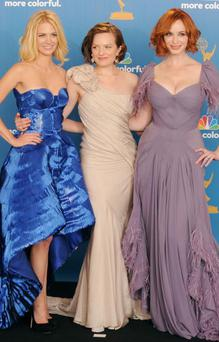LOS ANGELES, CA - AUGUST 29: (L-R) Actresses January Jones, Elisabeth Moss and Christina Hendricks, winners of the Outstanding Drama Series Award for