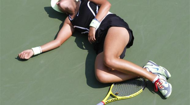 Victoria Azarenka of Belarus collapses on the court while playing Gisela Dulko of Argentina at Flushing Meadows