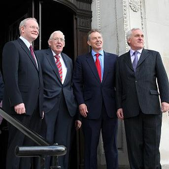 Tony Blair (second right) said he bent the truth to prevent the collapse of the Northern Ireland peace process
