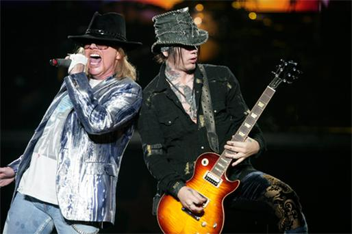 Singer Axl Rose and guitarist DJ Ashba on stage at the O2 before walking off