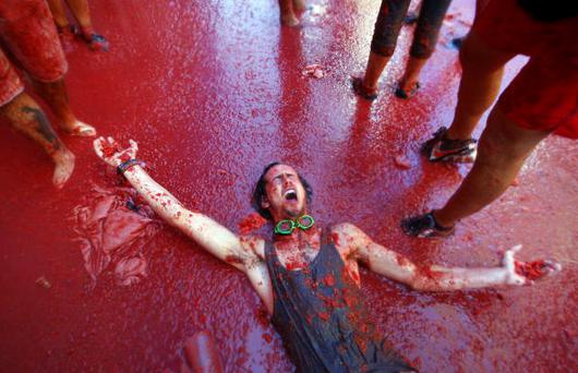 A man is pelted with tomatoes during the