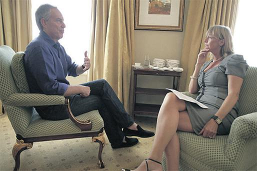 Lise Hand talking to former British leader Tony Blair in Dublin's Shelbourne Hotel yesterday. Photo: Collins
