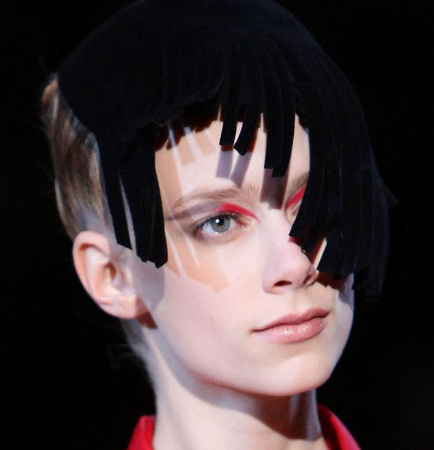 The look was 'pretty punk' at Armani with anarchic flashes of red eyeshadow on otherwise natural faces
