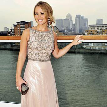 Kimberley Walsh has denied she's appearing on Strictly