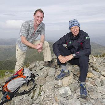 Alan Hinkes (right) is greeted on the summit of Helvellyn by Richard Leafe, chief executive of Lake District National Park