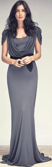 Draped maxi dress, €60. Sash bow belt, €7, Dunnes Stores. Black ring, stylist's own