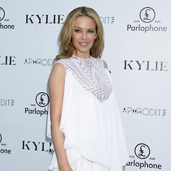 Kylie Minogue has announced she will tour in 2011