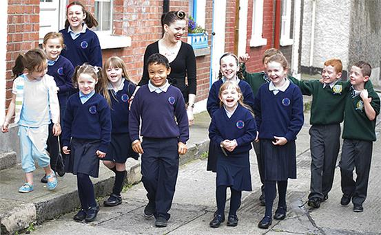 Imelda May takes to the streets of Dublin's Liberties with fans from the local schools yesterday