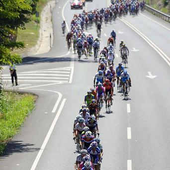The peloton snakes its way along the motorway at the start of yesterday's stage 10 of the Vuelta. Photo: Reuters