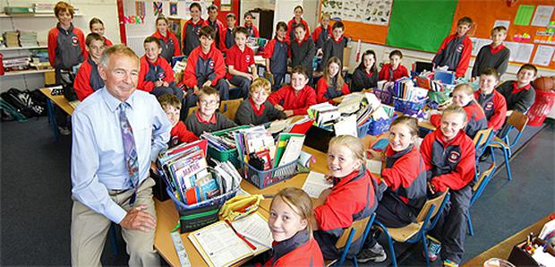 Teacher Kevin Healy with his 32 fifth-class pupils at the Divine Word National School in Marley Grange, Rathfarnham, Co Dublin, yesterday