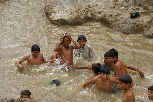 Children having fun in the muddy water next to Mundhigaz camp. All photos courtesy of Oxfam