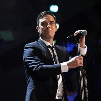 Robbie Williams is apparently thinking about settling down in Kent