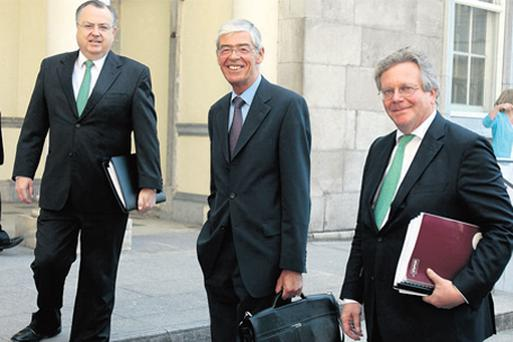 Mike Aynsley,Chief Executive of Anglo Irish Bank, Alan Dukes, Chairman and Maarten Van Eden, Chief Financial Officer