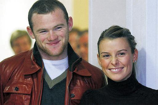 Wayne Rooney and his wife Coleen during rather happier times