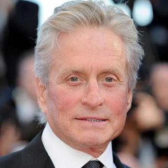 Michael Douglas has joked he's been able to catch up with his sport since his cancer was diagnosed