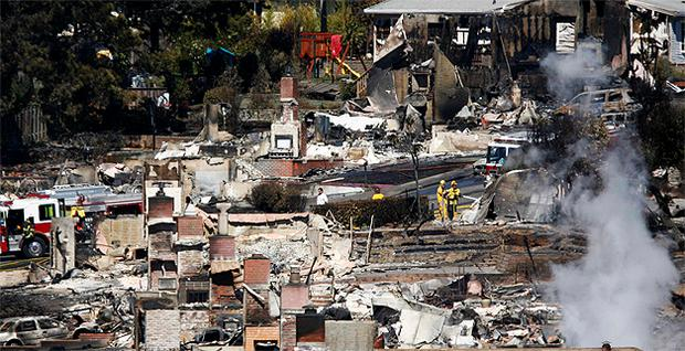 Firemen work on the remains of a home damaged by a massive gas explosion in a mostly residential neighborhood in San Francisco. Photo: Reuters