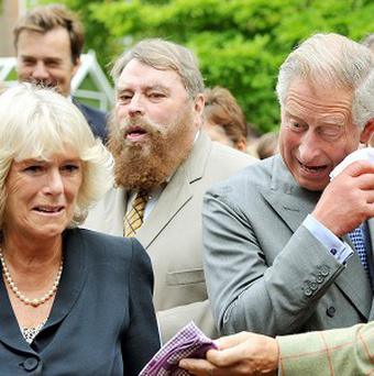 Charles and Camilla are caught in a fit of giggles as they watched a cat organ