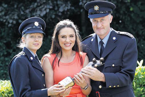 Gda Cathy Cotter (left) and Sgt Seamus O'Neill (right), recipients of the Garda of the Year award, with presenter Grainne Seoige at the People of the Year awards