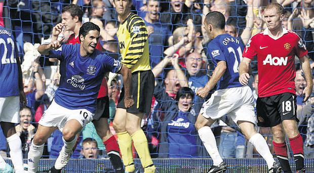 Everton's Mikel Arteta celebrates after scoring his side's dramatic injury time equaliser in the Premier League match at Goodison Park yesterday. Photo: Peter Byrne