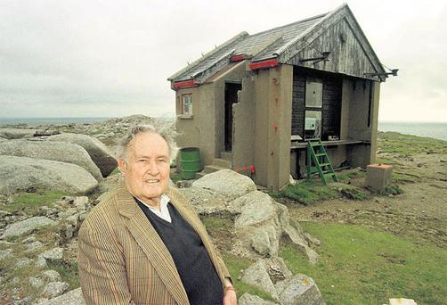 HIGH POINT: Derek Hill, whose work was shunned by Britain's artistic establishment, found fulfilment in Ireland. In this photograph, taken in 1999, he is outside his hut on Tory Island, where he lived and worked for many years. Bruce Arnold says Hill was captivated by 'the green depths of Irish scenery'