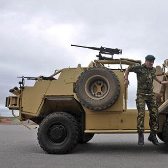 A soldier dismounts from the new 'Jackal 2' high mobility vehicle