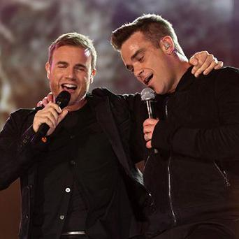 Robbie Williams and Gary Barlow performing at the Help For Heroes Concert at Twickenham Stadium, south west London.