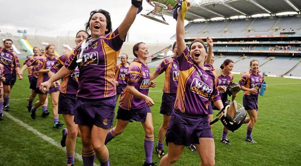 Wexford captain Una Leacy, left, with Michelle O'Leary lead the celebrations after winning the All-Ireland Senior Camogie Championship at Croke Park yesterday. Photo: Paul Mohan / Sportsfile