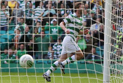 Paddy McCourt wheels away after scoring with another sublime finish for Celtic on Saturday. Photo: Reuters