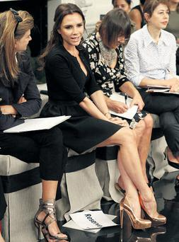 Victoria Beckham sat beside the catwalk as designs from her Spring 2011 collection were showcased in New York during Fashion Week.