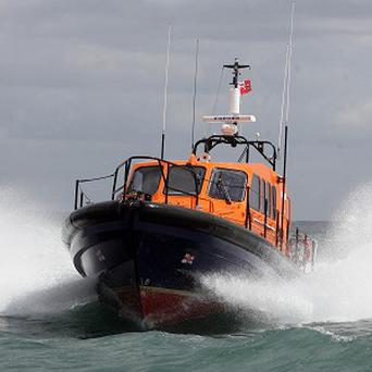 A lifeboat had to rescue a man who had gone to sea to save a wheelie bin